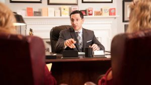 Daniel M. Rosenberg discussing case details with two clients.